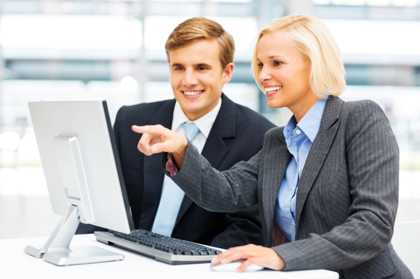 Business Colleagues At Computer Desk